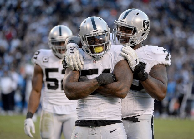 SAN DIEGO, CA - DECEMBER 18: Bruce Irvin #51 of the Oakland Raiders reacts to sacking Quarterback Philip Rivers #17 of the San Diego Chargers late in the fourth quarter en route to the Raiders 19-16 win over Chargers at Qualcomm Stadium on December 18, 2016 in San Diego, California. (Photo by Donald Miralle/Getty Images)