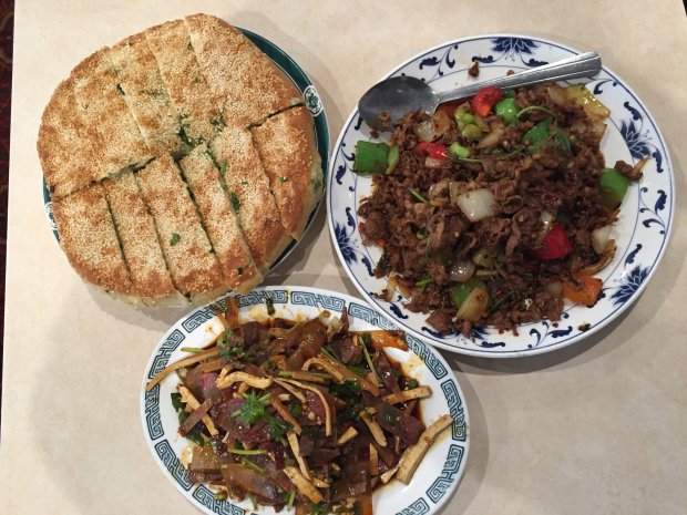 Spicy Chinese dishes make the perfect Christmas Day nosh, including,clockwise from top, the Spicy Three Combination, Thick Sesame Bread with Green Onion, and Cumin Lamb from Darda Seafood in Milpitas (Jessica Yadegaran/Bay Area News Group).