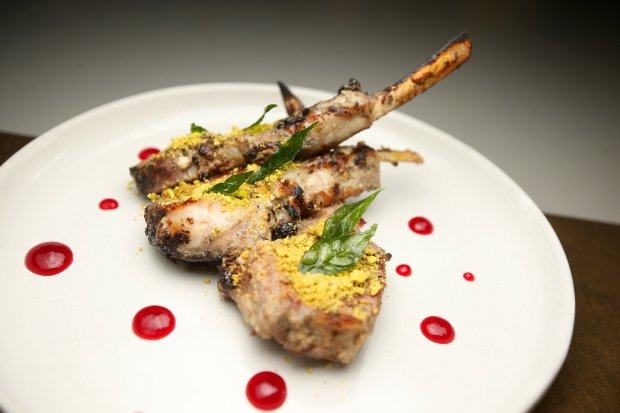 Lamb chops are photographed at August 1 Five on Wednesday, Dec. 21, 2016, in San Francisco, Calif. The dish consists of lamb chops, cashew paste, yogurt, cheese, mace, and cardamom. (Aric Crabb/Bay Area News Group)