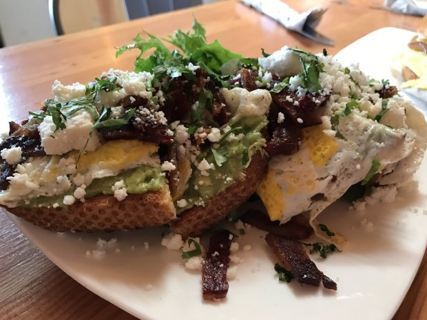 An Avocado Smash at Lafayette's Coffee Shop is terrific on its own, but afried egg and bacon tip the toast into sublime territory. (Jackie Burrell/Bay Area News Group)