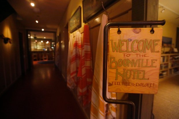 A sign welcomes guests to the Boonville Hotel in the lobby area in Boonville, Calif. on Thursday, Dec. 15, 2016. (Laura A. Oda/Bay Area News Group)