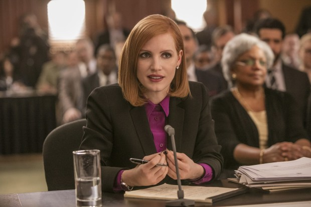 """This image released by Europa shows Jessica Chastain in a scene from, """"Miss Sloane."""" (Kerry Hayes/Europa via AP)"""