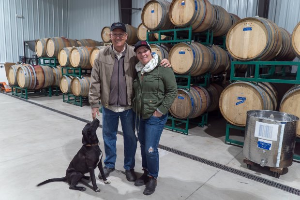 Winery dog Jet with Bob and Maggie Tillman in Alta Colina's barrel room.Photo credit: Courtesy of Jon Orlin