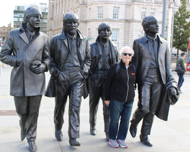 Courtesy of Eileen WolkENGLAND: San Jose resident Eileen Wolk's recent trip to Great Britain included a stop in Liverpool, where she turned the Fab Four into the Fab Five.