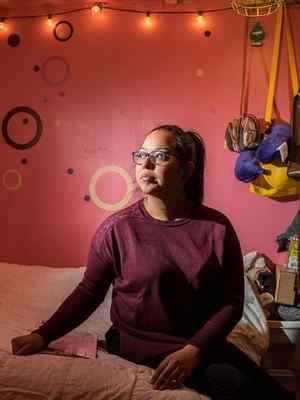 Mitzie Perez, 25, sits in her bedroom in San Dimas on Dec. 7. Perez is a Deferred Action for Childhood Arrivals (DACA) recipient and hopes to travel to her birth place in Guatemala to see her grandparents. (PHOTO BY YUNUEN BONAPARTE)
