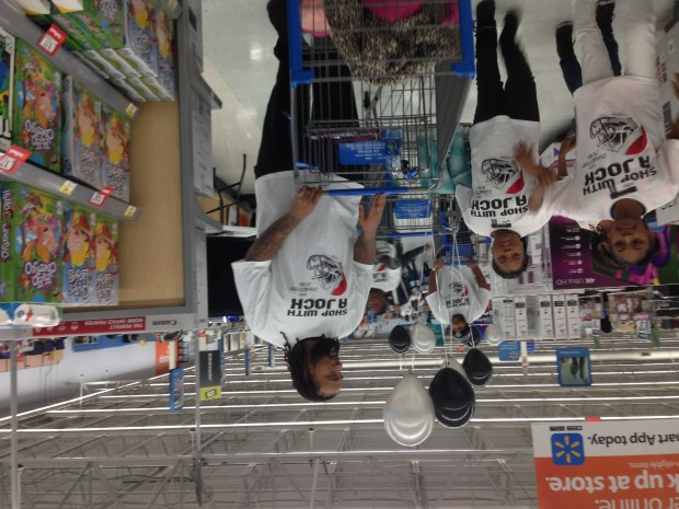 "Raiders left tackle Donald Penn hosts his annual ""Shop with a Jock"" event where he invited 25 children from the East Oakland Youth Development Center to a $200 shopping spree at the San Leandro Walmart on Dec. 13, 2016. (Jerry McDonald/Staff)"