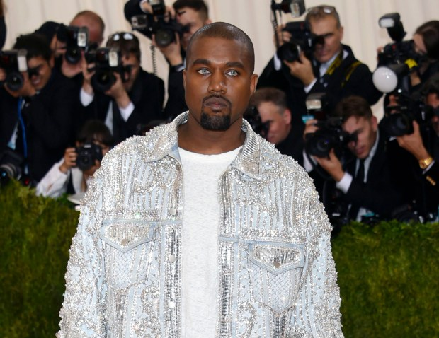 "FILE - In this May 2, 2016 file photo, Kanye West arrives at The Metropolitan Museum of Art Costume Institute Benefit Gala, celebrating the opening of ""Manus x Machina: Fashion in an Age of Technology"" in New York. West was taken to Ronald Reagan UCLA Medical Center in Los Angeles on Monday, Nov. 21, for stress and exhaustion. (Photo by Evan Agostini/Invision/AP)"