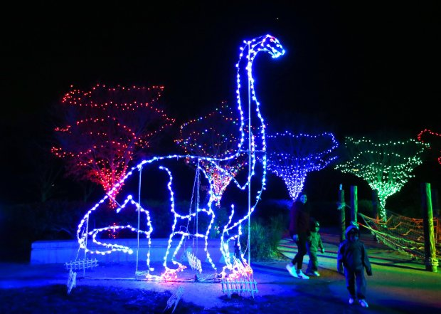 Visitors walk past holiday light displays at the Oakland Zoo on Tuesday, Dec. 6, 2016, in Oakland, Calif. ZooLights runs nightly from 5:30 pm to 9pm until January 1, 2017. (Aric Crabb/Bay Area News Group)
