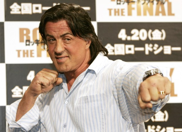 """FILE – In this March 26, 2007, file photo, actor and screenwriter Sylvester Stallone poses for a photo during a news conference to promote the movie """"Rocky Balboa"""" at a hotel in Tokyo. Four decades after the Nov. 21, 1976, premiere of """"Rocky,"""" the movie's reach is international, and the title character's underdog tale of determination, grit and sleepy-eyed charm still resonates with fans. (AP Photo/Vincent Thian, File)"""