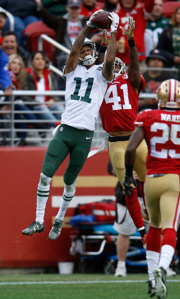 New York Jets' Robby Anderson (11) makes a catch against San Francisco 49ers' Antoine Bethea (41) in the third quarter of their NFL game at Levi's Stadium in Santa Clara, Calif., on Sunday, Dec. 11, 2016. (Nhat V. Meyer/Bay Area News Group)