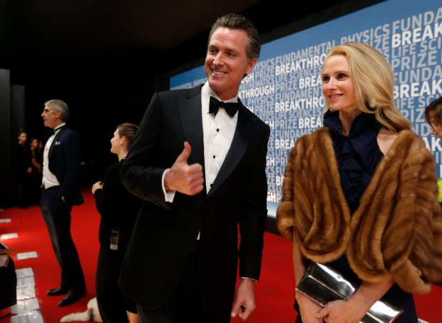 Lieutenant Governor Gavin Newsom gives a thumbs up while walking on the red carpet with this wife Jennifer before the Breakthrough Prize ceremony at Moffett Airfield in Mountain View, Calif., on Sunday, Dec. 4, 2016. (Nhat V. Meyer/Bay Area News Group)
