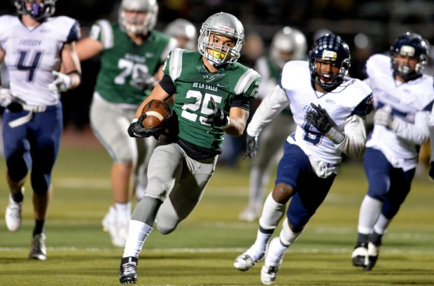 De La Salle High's Kairee Robinson (25) runs 31-yards for a touchdown in the second quarter of their North Coast Section Open Division playoff game against Freedom High in Dublin, Calif., on Friday, Dec. 2, 2016. (Doug Duran/Bay Area News Group)