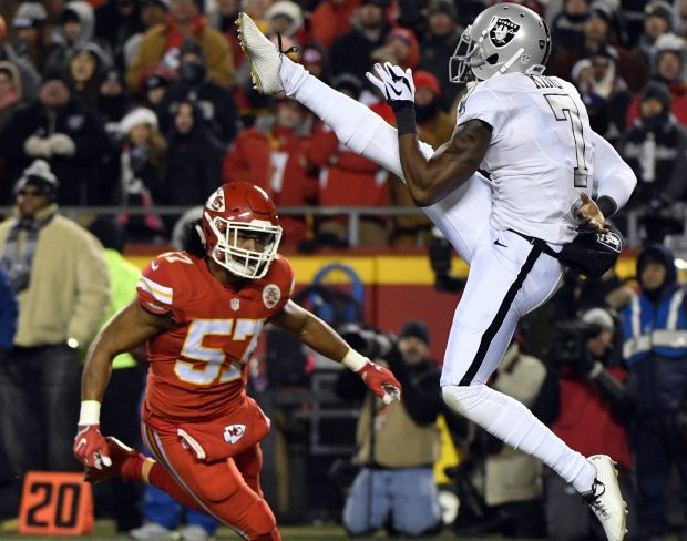 Oakland Raiders punter Marquette King (7) follows through with his punt as Kansas City Chiefs linebacker D.J. Alexander (57) closes in, during the first half of an NFL football game in Kansas City, Mo., Thursday, Dec. 8, 2016. (AP Photo/Ed Zurga)