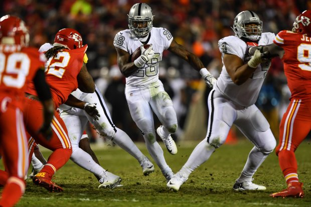 KANSAS CITY, MO - DECEMBER 8: Running back Latavius Murray #28 of the Oakland Raiders rushes through a hole against the Kansas City Chiefs at Arrowhead Stadium during the third quarter of the game on December 8, 2016 in Kansas City, Missouri. (Photo by Peter Aiken/Getty Images)