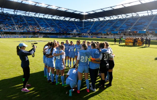 North Carolina and West Virginia huddle before their semifinal match for the Women's College Cup at Avaya Stadium in San Jose, Calif., on Thursday, Dec. 2, 2016. (Nhat V. Meyer/Bay Area News Group)