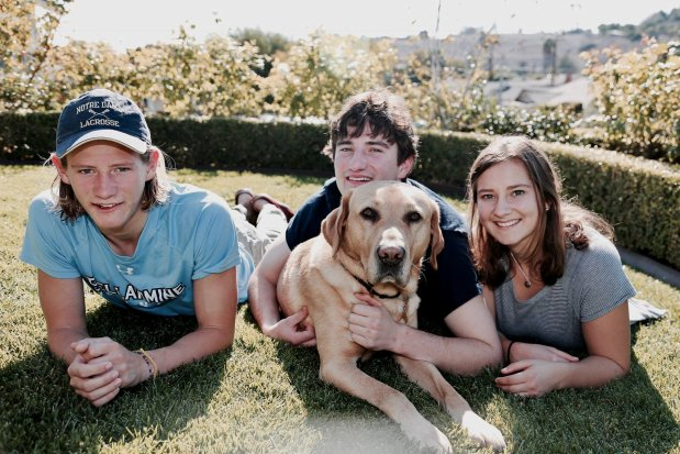 Alexis Doyle, right, with brothers Ryan, left, and Connor. The dog is Blake, who was raised as a guide dog, and now serves as a breeder for the Guide Dogs for the Blind organization. (Doug Doyle photo)