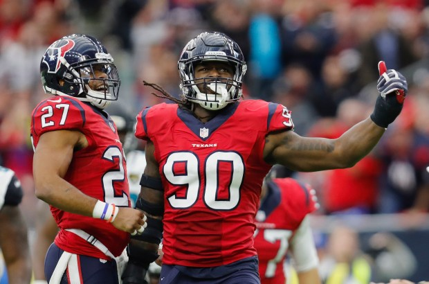 HOUSTON, TX - DECEMBER 18:  Jadeveon Clowney #90 of the Houston Texans celebrates with Quintin Demps #27 of the Houston Texans after a tackle in the fourth quarter against the Jacksonville Jaguars at NRG Stadium on December 18, 2016 in Houston, Texas.  (Photo by Tim Warner/Getty Images)