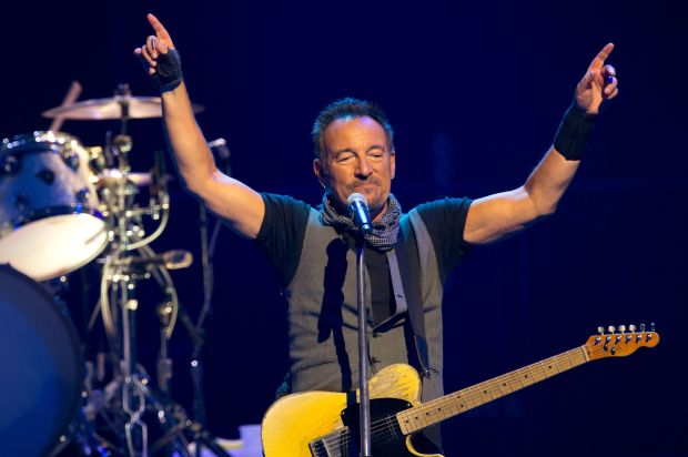 (FILES) This file photo taken on July 11, 2016 shows US musician Bruce Springsteen performs with The E Street Band at the AccorHotels Arena in Paris.A Bruce Springsteen archive will open at Monmouth University in New Jersey, a short distance from the working-class town where the rock legend grew up. The university near the Jersey Shore late January 10, 2017 announced the creation of the archive, which will store written works, photographs and other artifacts for future research. / AFP PHOTO / BERTRAND GUAYBERTRAND GUAY/AFP/Getty Images