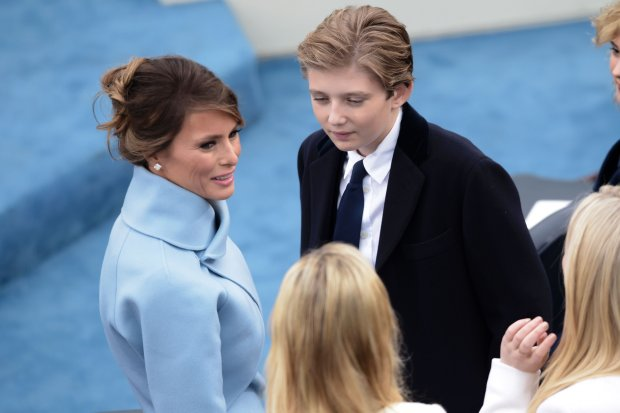 US First Laday Melania Trump and her son Barron Trump chat as they wait for the beginning of the swearing-in ceremony of US 45th President Donald Trump in front of the Capitol in Washington on January 20, 2017. / AFP PHOTO / Brendan SMIALOWSKIBRENDAN SMIALOWSKI/AFP/Getty Images