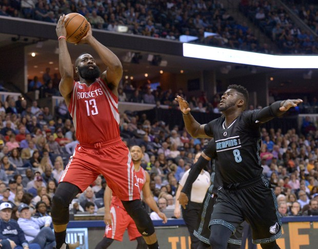 Houston Rockets guard James Harden (13) shoots against Memphis Grizzlies forward James Ennis (8) in the first half of an NBA basketball game Saturday, Jan. 21, 2017, in Memphis, Tenn. (AP Photo/Brandon Dill)