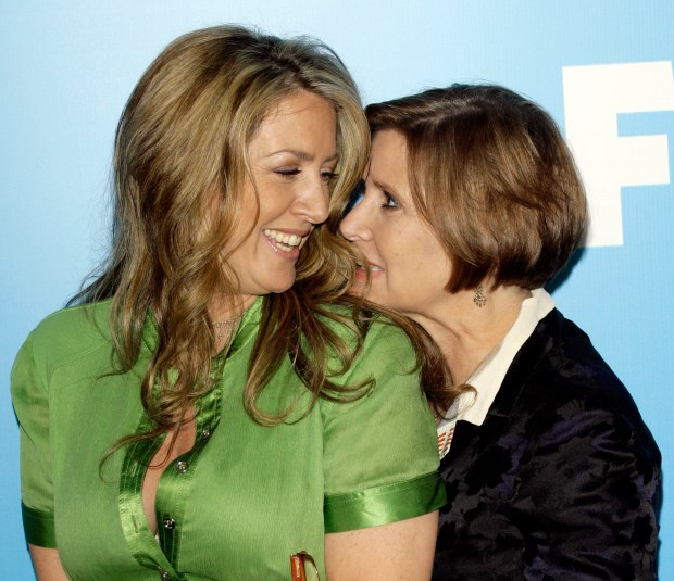 "Half-sisters Joely Fisher, left, and Carrie Fisher arrive to the Fox 2007 programming presentation in New York, Thursday, May, 17, 2007. Joely will appear in the new season of ""Til Death"", while Carrie is to appear in the new show, ""On the Lot"". (AP Photo/Stuart Ramson)"