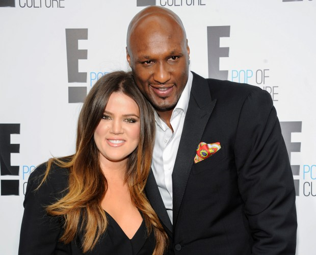 "FILE - In this April 30, 2012, file photo, Khloe Kardashian Odom and Lamar Odom from the show ""Keeping Up With The Kardashians"" attend an E! Network upfront event at Gotham Hall in New York. A Los Angeles judge on Friday, Dec. 9, 2016, finalized Kardashian and Odom's divorce nearly three years after she first filed to end their marriage. The pair were married in September 2009 and court records show many financial details of the divorce were subject to a prenuptial agreement. (AP Photo/Evan Agostini, File)"