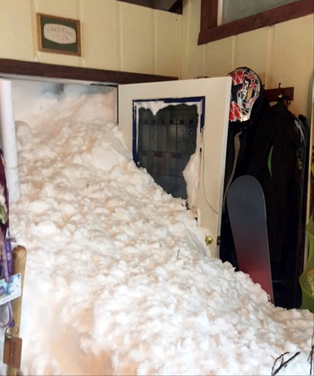 This Tuesday, Jan. 10, 2017 photo provided by Steven and Melissa Siig shows where snow has cascaded through a door of their home after one of several avalanches, some triggered by authorities, hit Alpine Meadows, Calif., in the north Lake Tahoe area. Officials said there was no major damage and no one was hurt. Several ski resorts in parts of the Sierra Nevada planned to stay shuttered Wednesday, including Squaw Valley and Alpine Meadows, which had no power because of the storm. (Steven and Melissa Siig via AP)