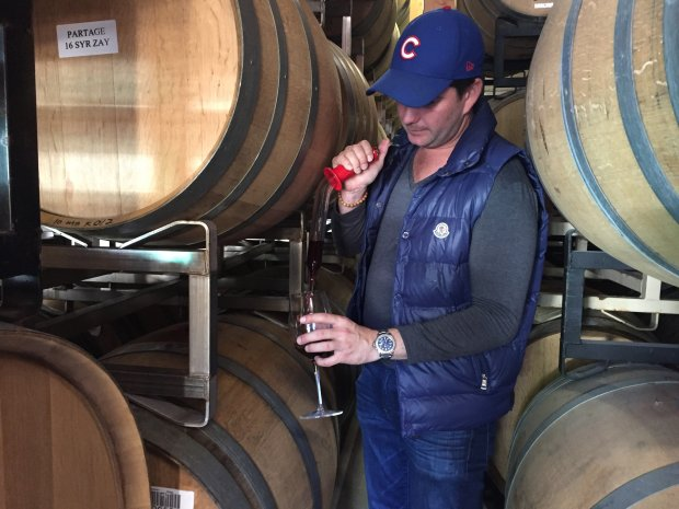 Mark Bright fills a glass with a sample of his wine label Partage's pinotnoir. Photo credit: Mary Orlin/Bay Area News Group