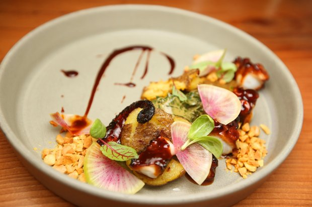 Charred octopus luau is photographed at aina restaurant on Tuesday, Jan. 10, 2017, in San Francisco, Calif. The dish consists of grilled octopus, rainbow swiss chard with coconut cream, vadouvan spiced almonds, and German butterball potato. (Aric Crabb/Bay Area News Group)