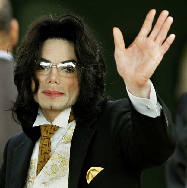 "(FILES) Michael Jackson waves as he arrives at the Santa Barbara County courthouse 03 June 2005, in Santa Maria, California. The executors of Michael Jackson's estate are expressing outrage over an ""insensitive"" television special ""in shockingly bad taste"" that plans to reenact the King of Pop's autopsy. In a letter to Discovery Communications on December 29, 2010, John Branca and John McClain deplored in the strongest terms the Discovery Channel's ""blind desire to exploit Michael's death, while cynically attempting to dupe the public into believing this show will have serious medical value."" AFP PHOTO/Timothy A. CLARY/FILES (Photo credit should read TIMOTHY A. CLARY/AFP/Getty Images)"