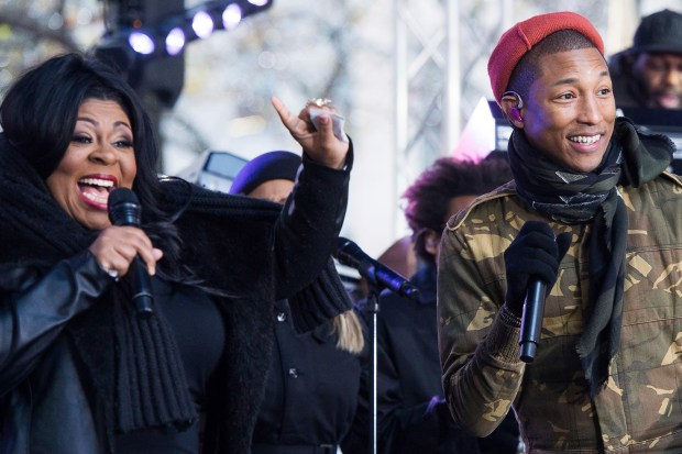 "Kim Burrell and Pharrell Williams perform on NBC's ""Today"" show at Rockefeller Plaza on Friday, Dec. 9, 2016, in New York. (Photo by Charles Sykes/Invision/AP)"