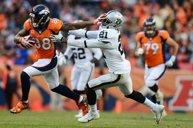 Wide receiver Demaryius Thomas #88 of the Denver Broncos stiff arms cornerback Sean Smith #21 of the Oakland Raiders in the third quarter of the game at Sports Authority Field at Mile High on January 1, 2017 in Denver, Colorado. (Photo by Dustin Bradford/Getty Images)