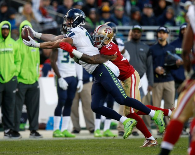 Seattle Seahawks' Tanner McEvoy (19) makes a catch against San Francisco 49ers' Dontae Johnson (36) in the fourth quarter of their NFL game at Levi's Stadium in Santa Clara, Calif., on Sunday, Jan. 1, 2017. (Nhat V. Meyer/Bay Area News Group)