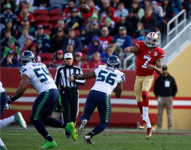San Francisco 49ers starting quarterback Colin Kaepernick (7) throws against Seattle Seahawks' Cliff Avril (56) in the first quarter of their NFL game at Levi's Stadium in Santa Clara, Calif., on Sunday, Jan. 1, 2017. (Nhat V. Meyer/Bay Area News Group)