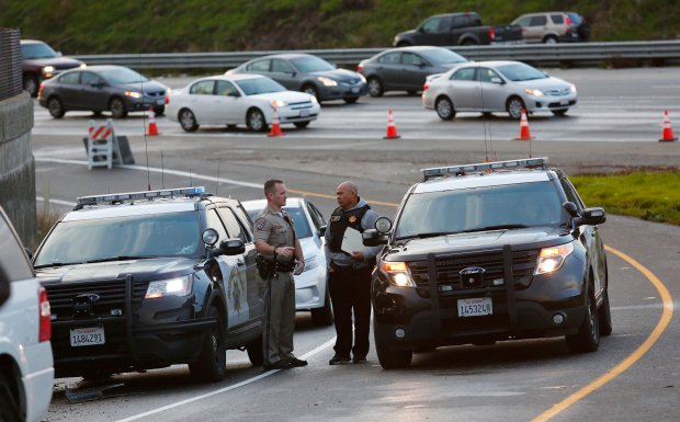 The California Highway Patrol and San Jose Police Department investigate a police involved shooting on the interchange of Highway 101 and Interstate 880 in San Jose, Calif., on Monday, Jan. 9, 2017. A suspect was shot and injured by CHP officers in the early morning hours. (Gary Reyes/Bay Area News Group)
