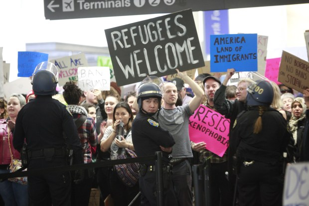 Protesters jam the north security gate to San Francisco International Airport, Sunday, Jan. 29, 2017, condemning President Trump's executive order banning citizens from seven Muslim-majority countries from entering the country. (Karl Mondon/Bay Area News Group)