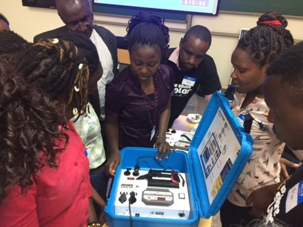 Members of Women in Solar Energy and Entrepreneurship in Kenya examine anewly arrived Solar Suitcase. The women are installing a solar panel on the roof of a school in rural Kenya as part of a We Share Solar solar electric system. We Share Solar is a project of Berkeley-based We Care Solar. (Photo courtesy We Care Solar)