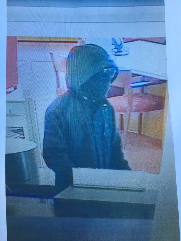 The man shown in this surveillance photo is suspected of robbing a Bank of America branch in Scotts Valley and leading police on a chase up Highway 17 to Redwood Estates on Jan. 26, 2017.