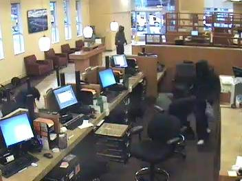 Two masked men, in the background and at right, robbed at gunpoint a Wells Fargo bank branch on Big Basin Way in Saratoga on Jan. 11, 2017