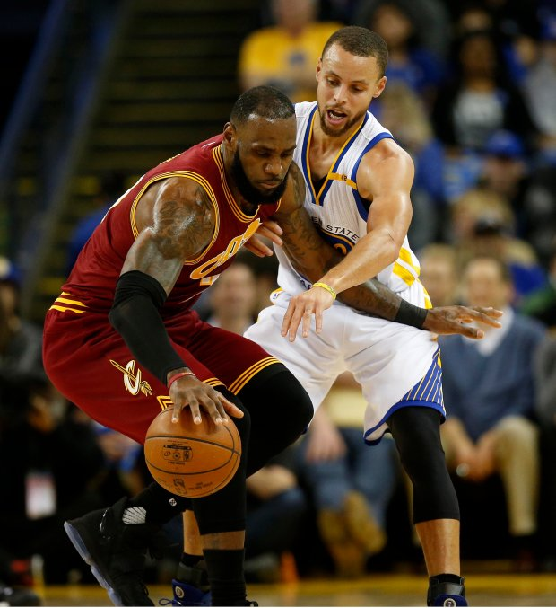 Golden State Warriors Stephen Curry (30) reaches in on Cleveland Cavaliers LeBron James (23) in the first quarter of their game at Oracle Arena in Oakland, Calif., on Monday, Jan. 16, 2017. (Jane Tyska/Bay Area News Group)