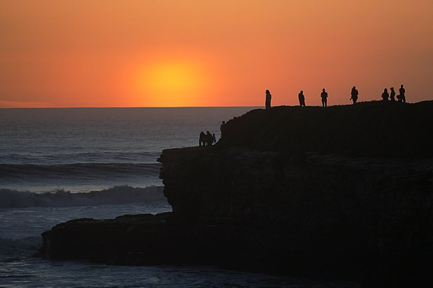 Sunset seekers gather on West Cliff to watch the end of the day disappear over the horizon. Santa Cruz has been treated to a series of golden sunsets over the past week. (Dan Coyro -- Santa Cruz Sentinel)