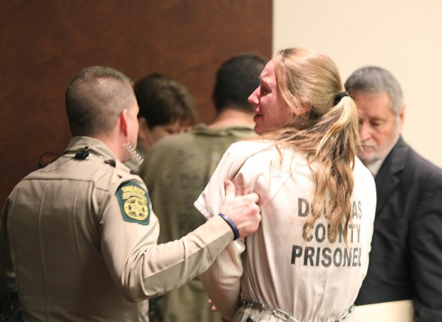 "Kayla Norton yells ""I love you guys!"" to the crowd that gathered to support her at her sentencing at the Douglas County Courthouse in Douglasville, Ga., Monday, Feb. 27, 2017. (Henry P. Taylor/Atlanta Journal-Constitution via AP)"