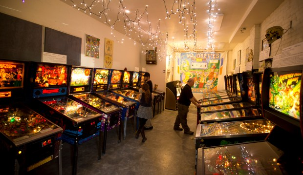 Unidentified patrons play the games at the Pacific Pinball Museum, Tuesday, Jan. 13, 2015 in Alameda, Calif. The museum recently received permission from the city to move the more than 90 historic games into the site of the former Carnegie Library site, across from City Hall. (D. Ross Cameron/Bay Area News Group)
