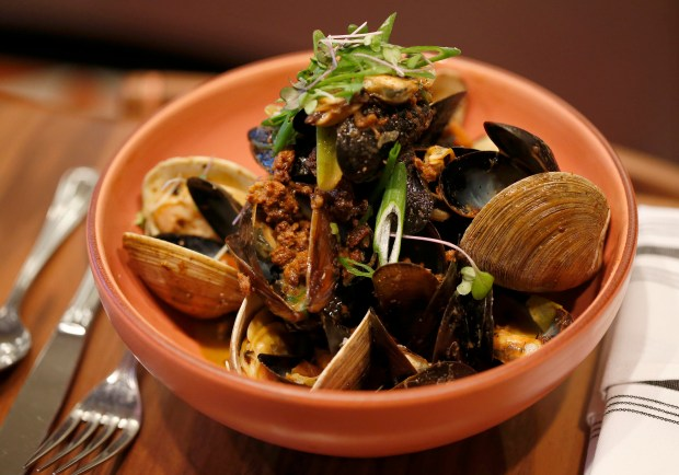 The Mussels, Clams & Chorizo dish is seen at Duchess on College Avenue in Oakland, Calif., on Thursday, Feb. 8, 2017. The restaurant, which opened in Dec. 2016, aims to serve comfort food in style for breakfast, lunch and dinner. (Jane Tyska/Bay Area News Group)