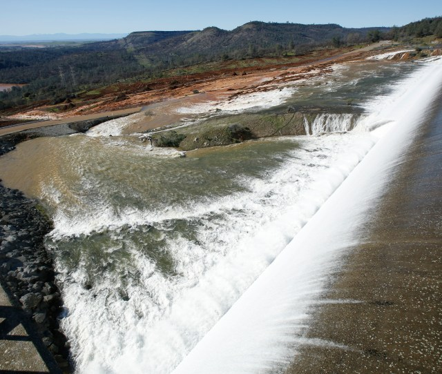 Water Flows Over The Emergency Spillway At Oroville Dam Saturday Feb 11 2017 In Oroville Calif Water Started Flowing Over The Emergency Spillway At