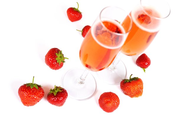 Strawberries tint a sparkling wine cocktail a rosy pink. (Thinkstock)