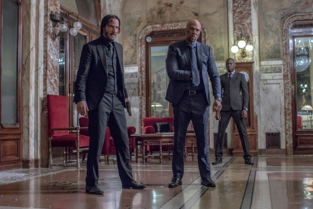 "This image released by Lionsgate shows Keanu Reeves, left, and Common in a scene from, ""John Wick: Chapter 2."" (Niko Tavernise/Lionsgate via AP)"
