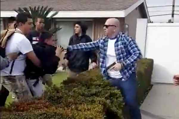 A still frame from a video appears to show a scuffle between teens and an off-duty Los Angeles Police Department officer in Anaheim on Tuesday, Feb. 21, 2017. At one point, the officer fired his gun, but no one was hurt. (Photo courtesy of YouTube video screengrab)