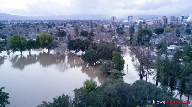 Courtesy Kevin Lowe - A still photo captured from a drone video depicts the extensive flooding which enveloped East William Street and William Street Park in San Jose, Calif. on Tuesday, Feb. 21, 2017.