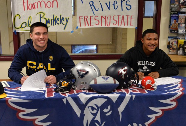 Freedom High School football players Kyle Harmon, left, and Ronnie Rivers have their photos taken after signing their letters of intent in Oakley, Calif., on Wednesday, Feb. 1, 2017. Harmon will be going to UC Berkeley and Rivers will be attending Fresno State. (Doug Duran/Bay Area News Group)